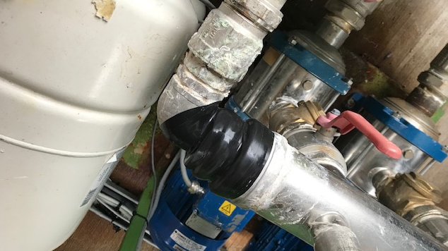 Wrap & Seal Pipe Burst Tape applied to a leaking CHP System