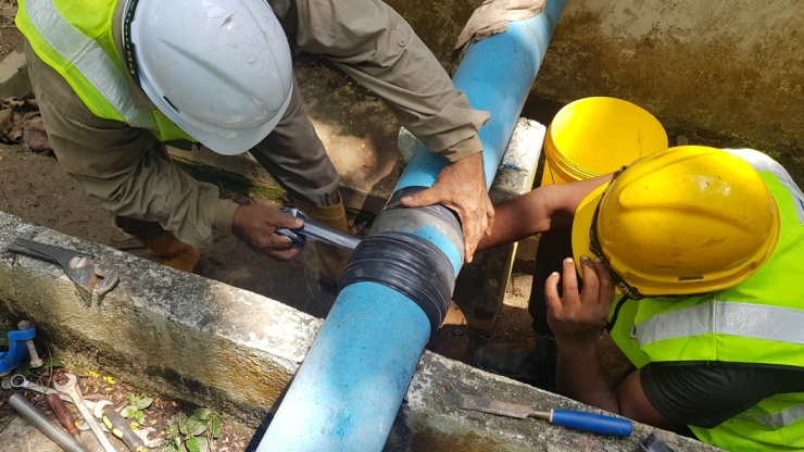 Pipe Repair Installation taking place in Malaysia using a SylWrap Pipe Repair Kit