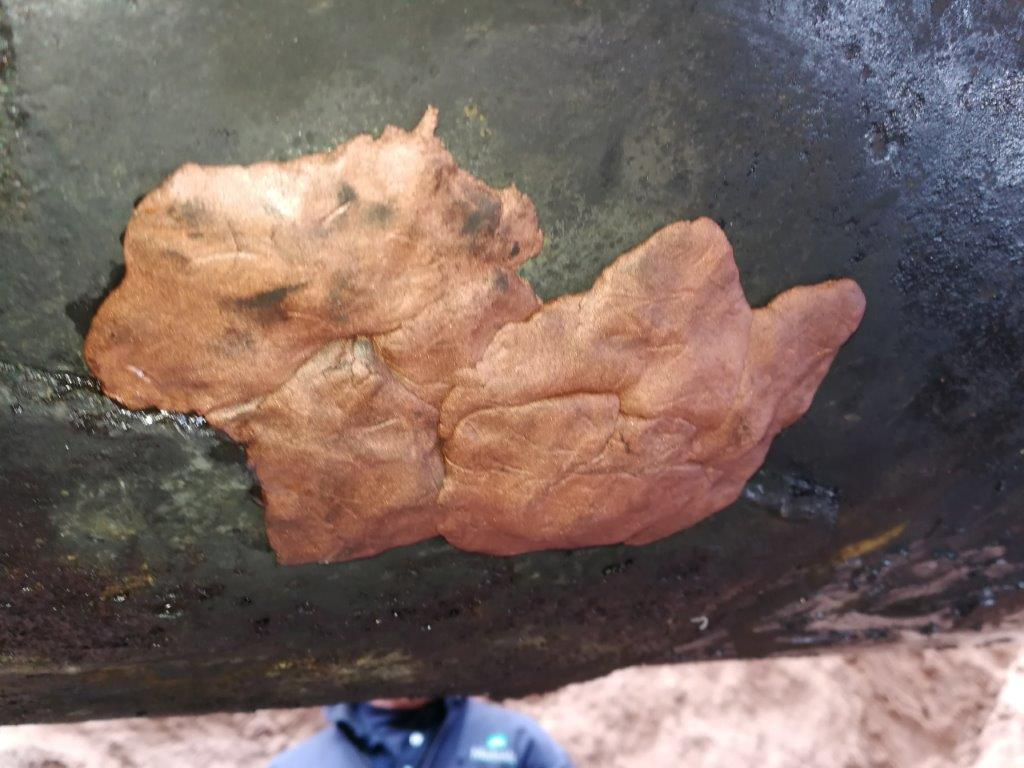 Superfast Copper Epoxy Putty used to restore the surface profile of a 900mm steel pipe in an Argentina oil well