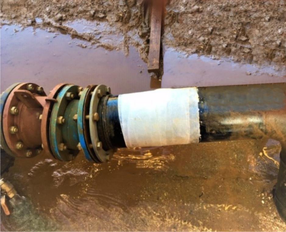 Quarry aggregate wash plant plastic pipe repair made using a SylWrap Standard Pipe Repair Kit