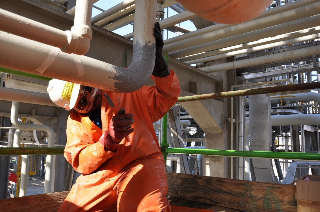 Industrial Metal used to reinforce a 100mm sulphuric acid elbow pipe at a petrochemical refinery in Saudi Arabia