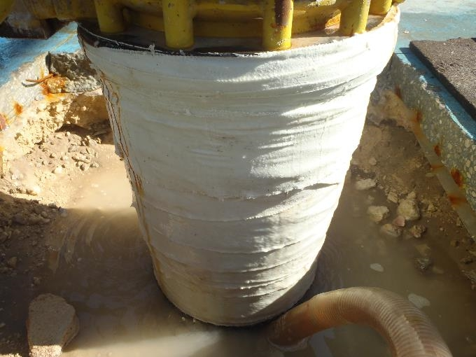 Completed repair of a cracked PCCP pipe stub using a SylWrap Pipe Repair kit