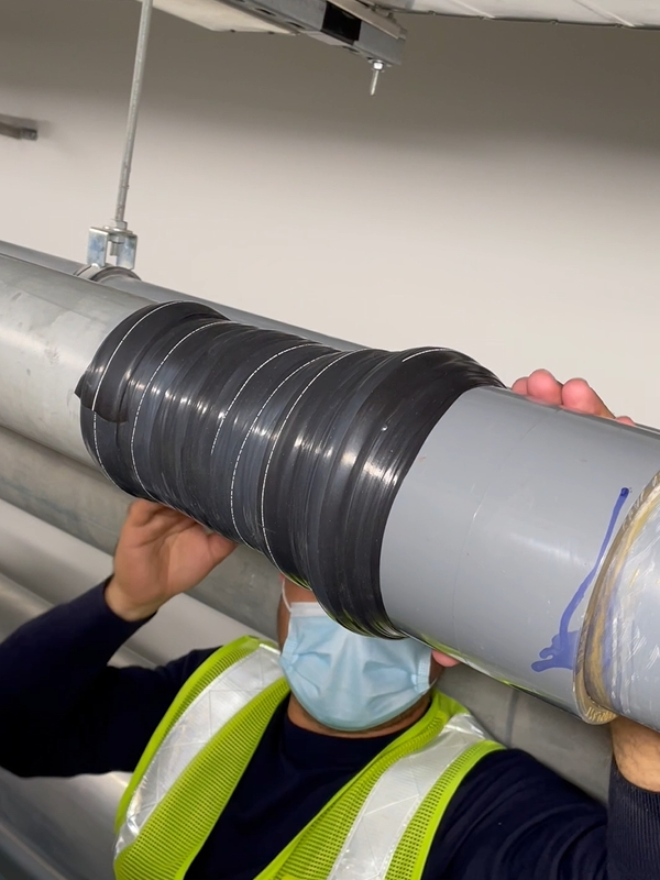 Wrap & Seal Pipe Burst Tape used to encompass a leaking step joint on a 100mm UPVC pipe at Bahrain International Airport