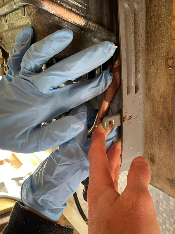 Superfast Copper Epoxy Putty Stick applied to a crack in a pipe in a camper van boiler system